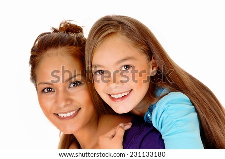A closeup picture of a mother and daughter playing for isolated white  background, the girl sitting on the back of her mother.
