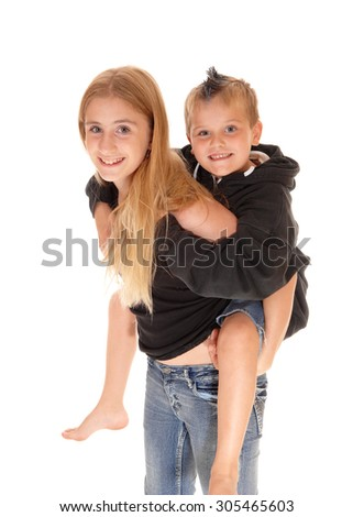 A closeup picture of a young girl caring her little brother on her back,