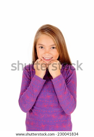 A closeup picture of a young girl holding her hands at her face, smiling happy, standing isolated for white background.  - stock photo