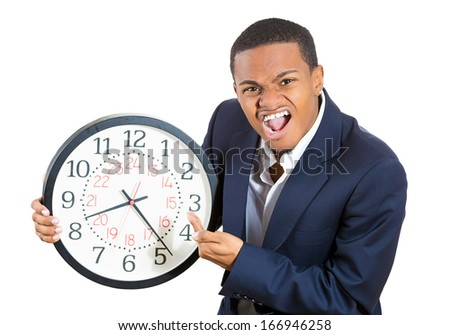 A closeup portrait of a business man, executive, leader holding a clock, very determined, pressured by lack of time, running out of time, late for the meeting, isolated on a white background. Emotions - stock photo