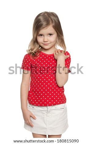 A closeup portrait of a fashion preschool girl on the white background