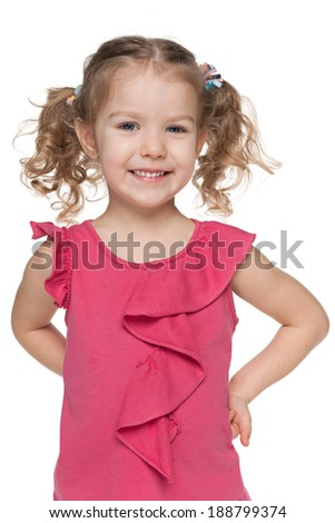 A closeup portrait of a happy little girl against the white background - stock photo