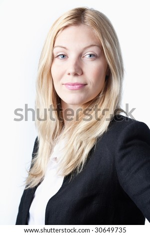 A closeup portrait of a young businesswoman on a white background - stock photo