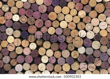 A closeup random selection of used wine corks, some with vintage years in horizontal format.