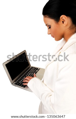 A closeup shoot of a pretty business woman, working on a laptop, in a white business suit, on white background.