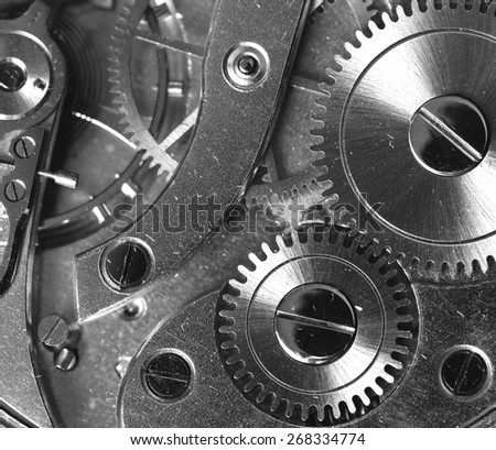 A closeup shot from a clock's clockwork. Image in black and white. - stock photo