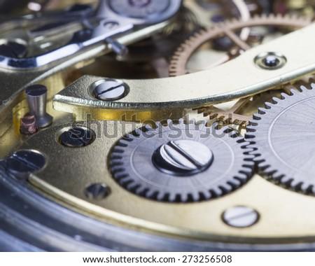A closeup shot of a magnificent clockwork. - stock photo