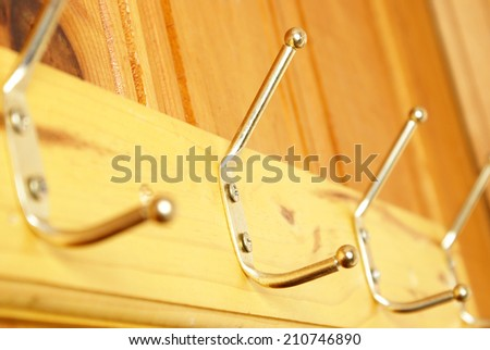 A closeup shot of a wooden coat rack for storage. - stock photo