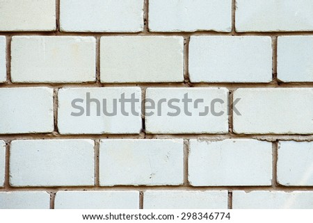 A closeup vertical image of old white textured bricks wall. - stock photo