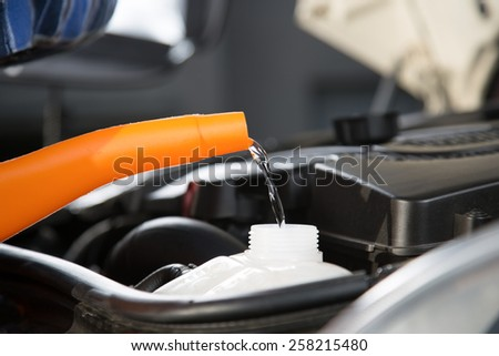 A closeup view from refilling a car with fresh water.