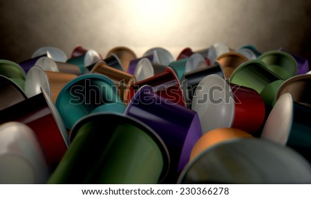 A closeup  view of a collection of colorful instant espresso coffee capsules sealed with foil on an isolated white background - stock photo