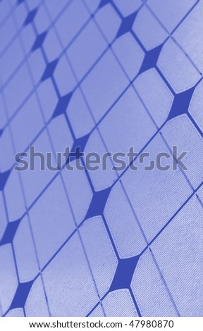 A closeup view of a panel of solar cells - stock photo