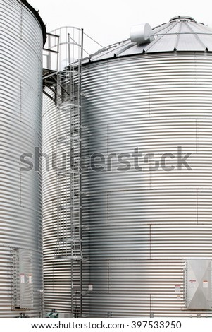 A closeup view of the corrugated metal on a group of granaries for storing wheat and other cereal grains.   - stock photo
