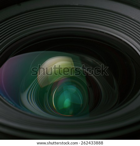 A closeup view of the glass elements in a camera lens - stock photo