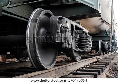 A closeup view of the wheels of a train - stock photo
