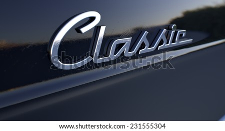 A closeup view of the word classic writting as a chrome emblem in a retro font set on a car painted in reflective black paint - stock photo