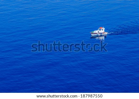 A closup of a fishing boat on a sea, Greece - stock photo