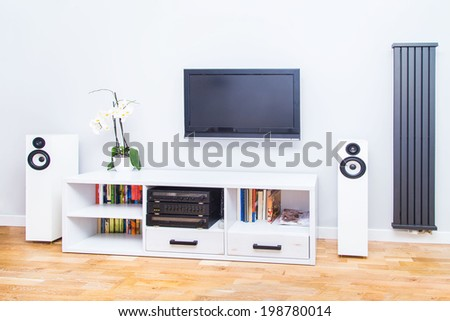 A closup of modern living room equipment with TV, stereo - stock photo