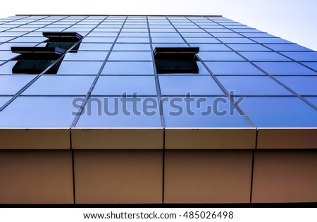 A clouds reflection in glass wall of business building with open windows natural color, glass open windows wall of skyscraper with closed windows with clouds reflection, high resolution