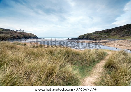 A cloudy day at Poldhu Cove near Mullion on the Lizard peninsula in Cornwall - stock photo
