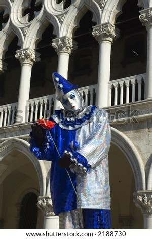 A clown dressed in silver and purple,poses in Saint Marks Square,Venice,Italy,in preperation for Carnivale,the mardi gras of Europe.