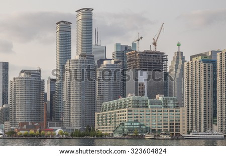 A cluster of high-rise buildings line the waterfront between Toronto Plant and Queen's Quay Terminal. - stock photo