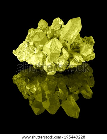 A cluster of well developed yellow limonite quartz crystals with their reflection. - stock photo