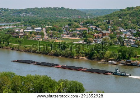 A Coal Barge On The Ohio River At Bellevue And Dayton Kentucky Across From Cincinnati Ohio USA - stock photo