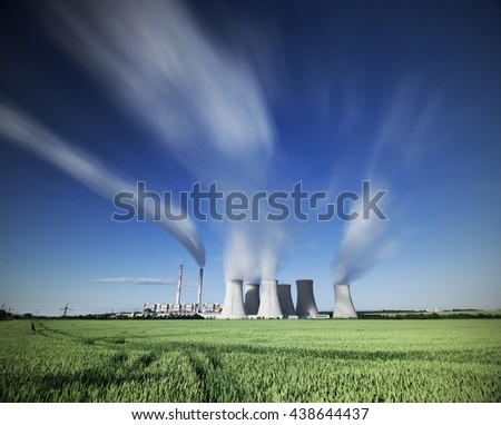 A coal-fired power station in the distance in agricultural landscape. long time, Pocerady, Czech republic
