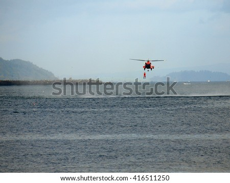 A Coast Guard Helicopter Practicing a Sea Rescue - stock photo