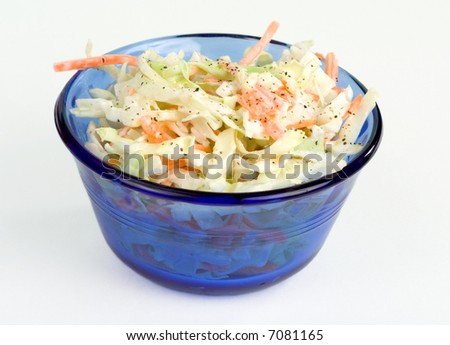 A cobalt blue bowl of fresh coleslaw.