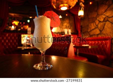 A cocktail at a retro bar. - stock photo