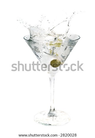 A cocktail drink with an olive splash - stock photo