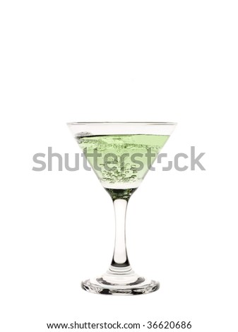 A cocktail glass with green liquid in it.