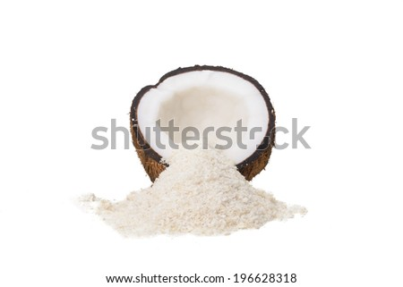 A Coconut Half and a Pile of Shredded Coconut Isolated on a White Background - stock photo