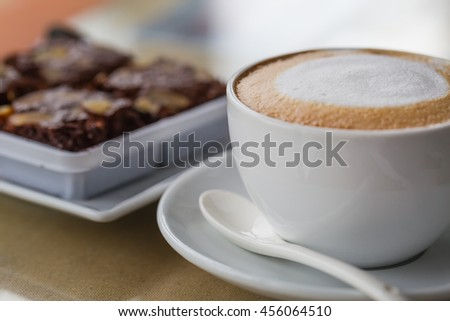 A coffee and cakes.