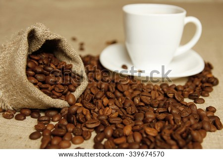 a coffee beans and a mug for background - stock photo