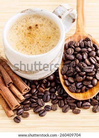 A Coffee cup and coffee beans on  wooden panel - With copy space,concept for Coffee and Aroma refreshing. - stock photo