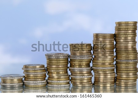 A coin graph with the topic growth and success - stock photo