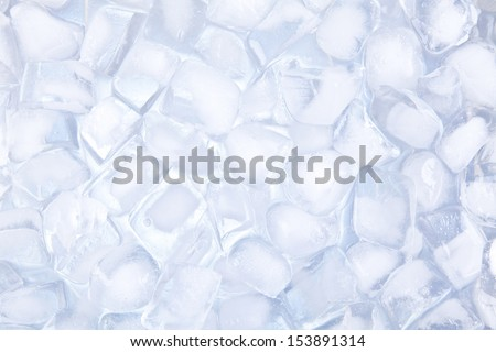 A cold color temperature ice cubes background. - stock photo