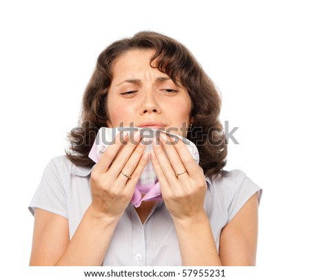 A cold girl sneezes