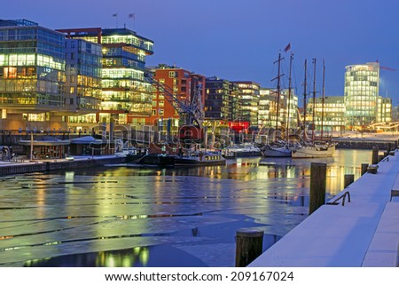A cold night in the Hafencity in Hamburg Germany - stock photo