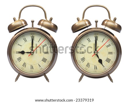 a collage of an old fashioned alarm clock, showing nine o?clock and five oclock isolated on white with clipping path - stock photo