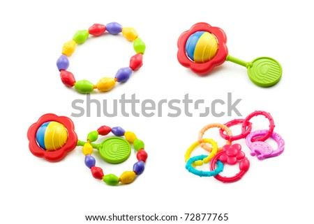 A collage of baby toys including teething rings, and rattles isolated on a white horizontal background - stock photo