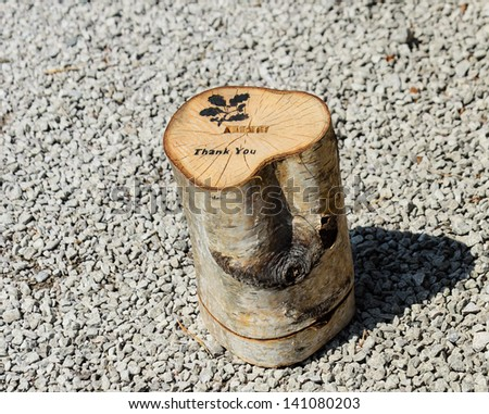 A collection box fashioned out of a trunk of a tree