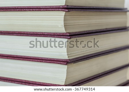 a collection of books in the volumes containing the story on their pages and wealth knowledge hidden inside / a rich collection of books
