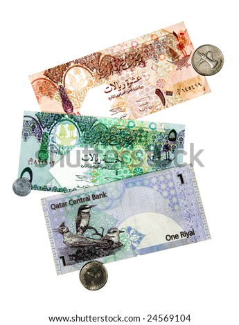 A collection of coins and currency from the Middle East. - stock photo