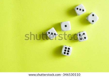 A collection of dices that has been rolled and landed on different numbers - stock photo