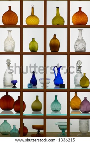 A collection of glass bottles in different shapes and colors. More with keyword Series003. - stock photo