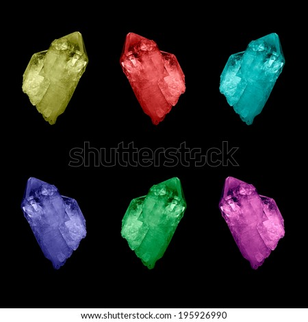 A collection of large brightly colored berg quartz crystals. - stock photo